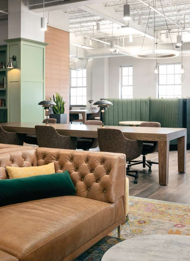 An elegant workspace with sofas, tables and chairs at Life Time Work