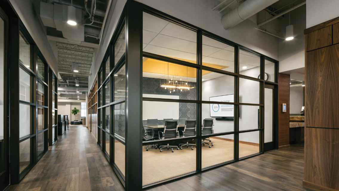 a glass enclosed conference room at Life Time Work