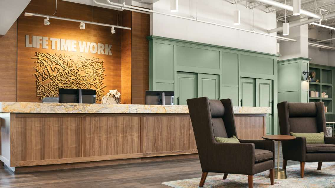 Front desk and lounge area at Life Time Work